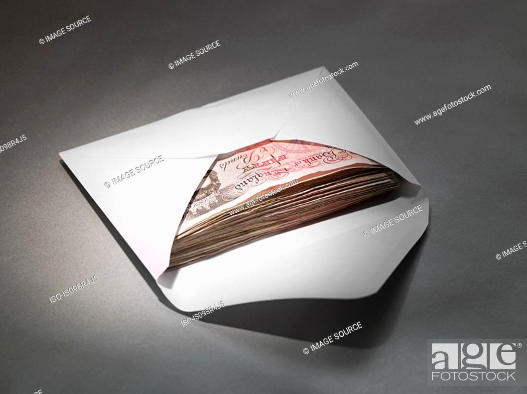 Stock Photo: Fifty pound notes in an envelope.