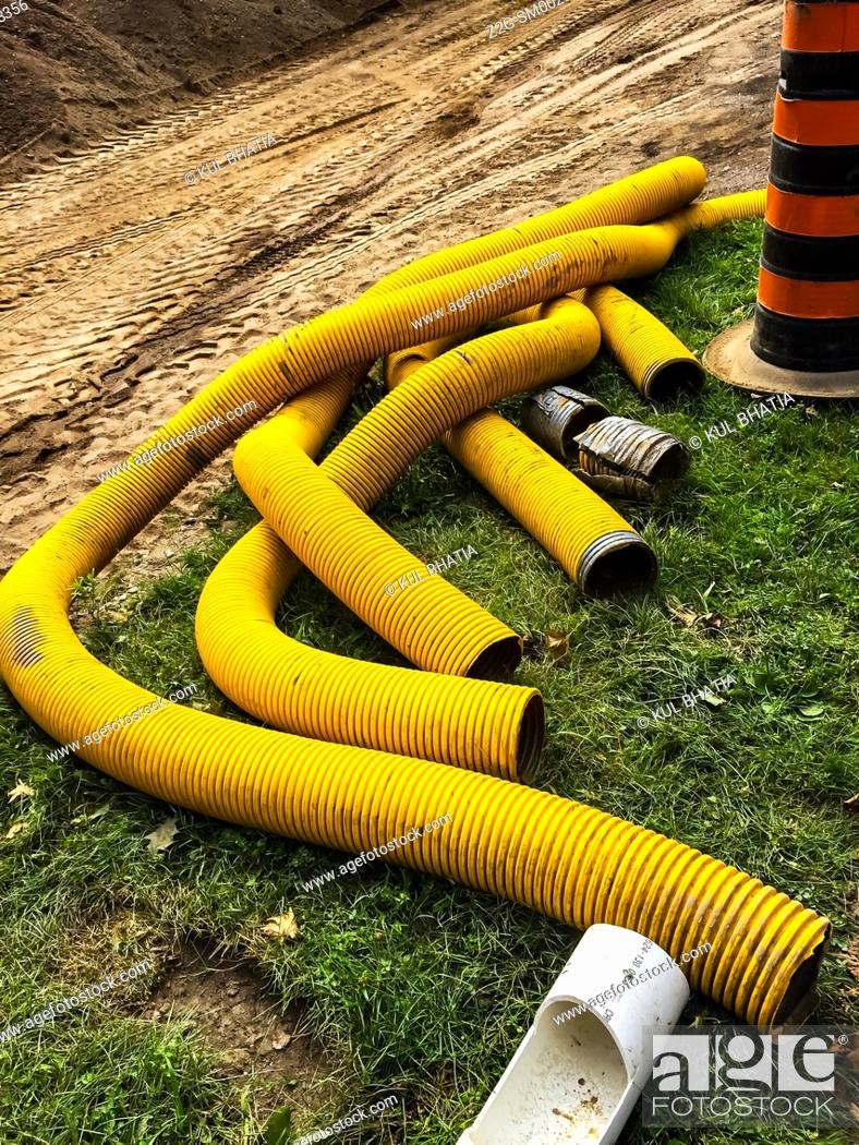 Stock Photo: High capacity hoses at a street-refurbishing site, Ontario, Canada.
