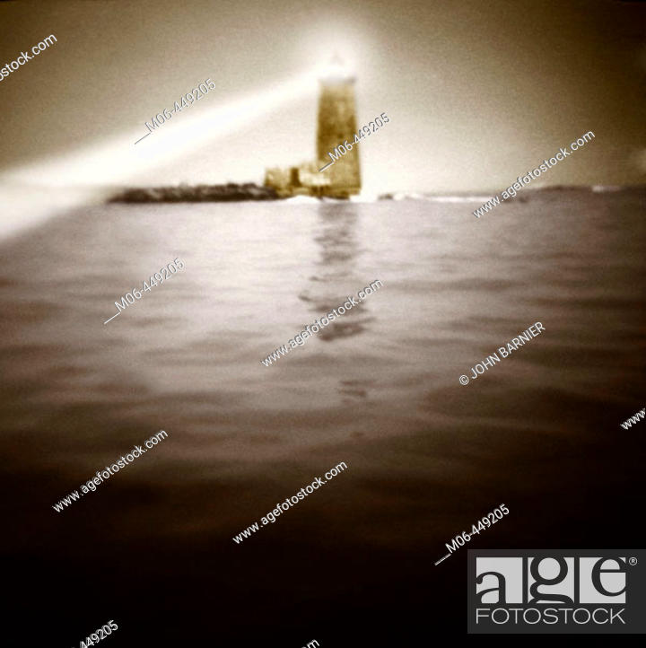 Stock Photo: Lighthouse with beam of light toi. the left.