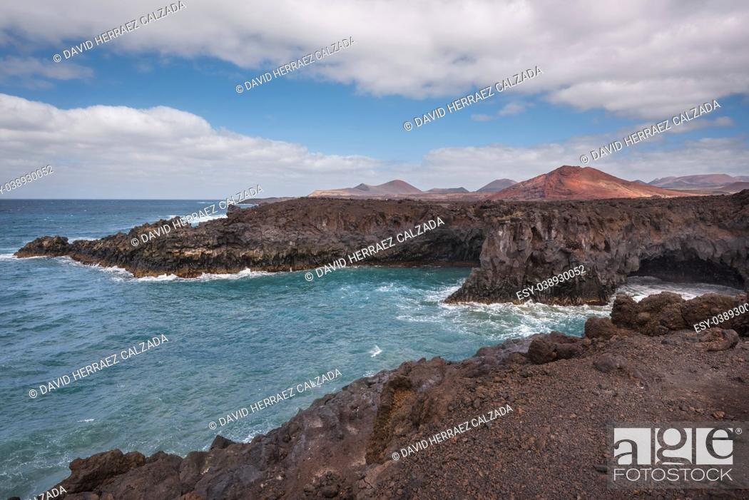 Stock Photo: Lanzarote landscape. Los Hervideros coastline, lava caves, cliffs and wavy ocean. No people appears in the scene.