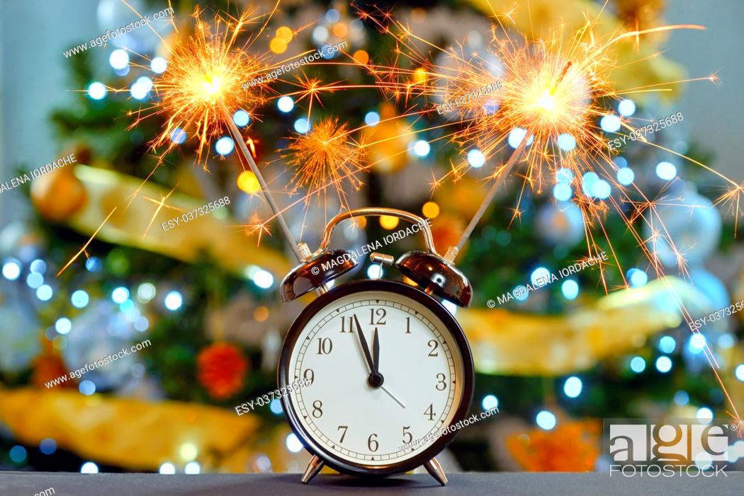 Stock Photo: Happy New Year concept with Sparkler Fireworks and clock.