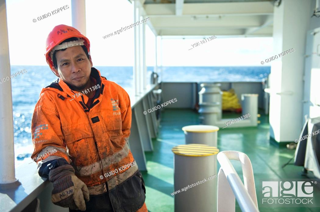 Stock Photo: Baltic Sea near Sweden. Portrait of an Indonesian seaman or sailor on the container-vessel MV Flintercape, during a journey from Rotterdam, Netherlands.