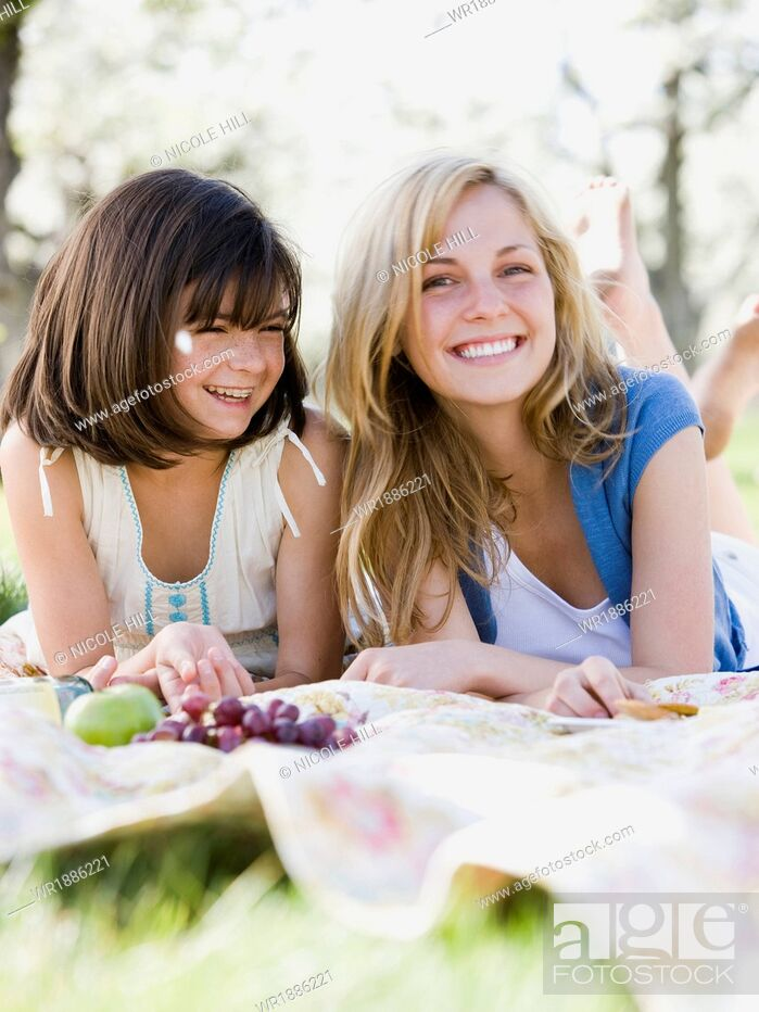 Stock Photo: mother and daughter in a blossoming orchard.