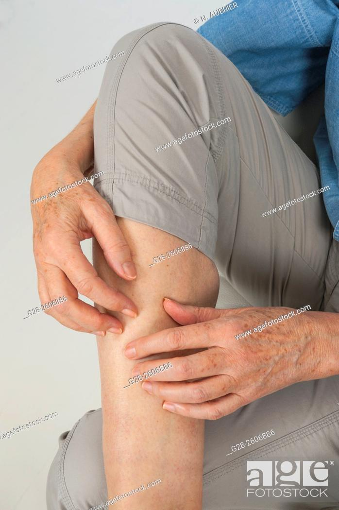Stock Photo: Thigh pain and scratching.