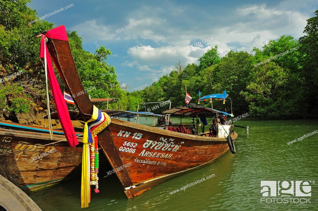 Stock Photo: boats docked in Krabi River, Krabi, Thailand.