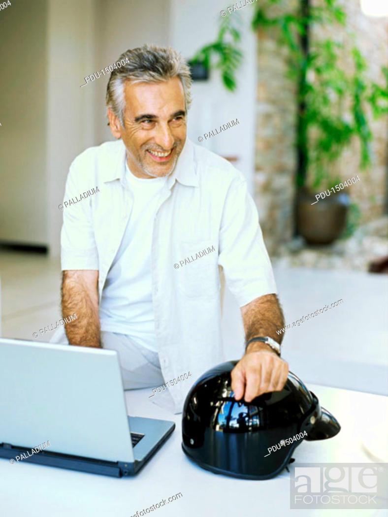 Stock Photo: Senior man using a laptop.