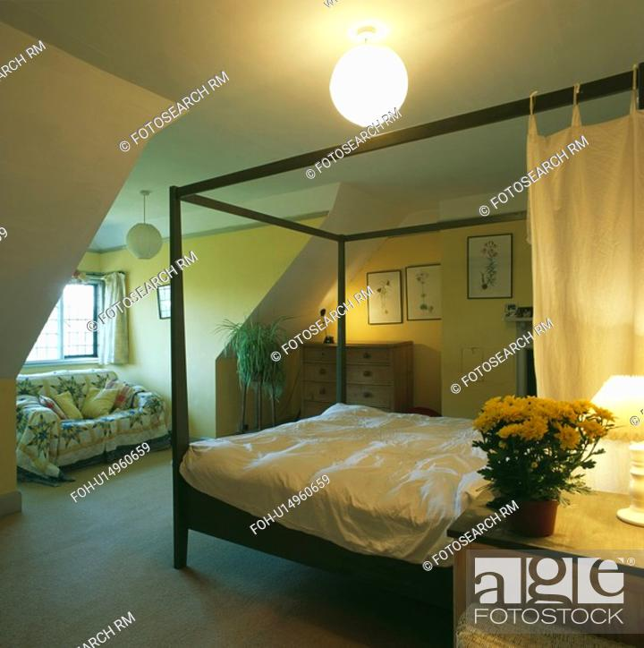 Stock Photo Modern Metal Fourposter Bed In Attic Bedroom With Central Light