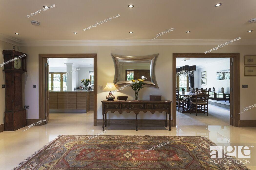 Photo de stock: Rug and doorways in traditional foyer.