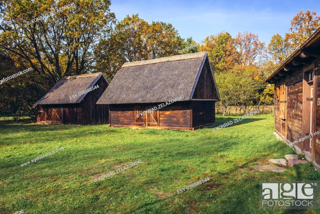 Stock Photo: Wooden farm buildings in Ethnographic Heritage Park, part of Museum of Kampinos Forest in Granica, small village in Kampinos Forest, Poland.