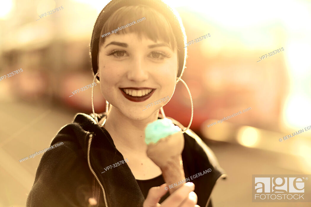 Stock Photo: woman with ice cream during sunny winter day in city Cottbus, Brandenburg, Germany.