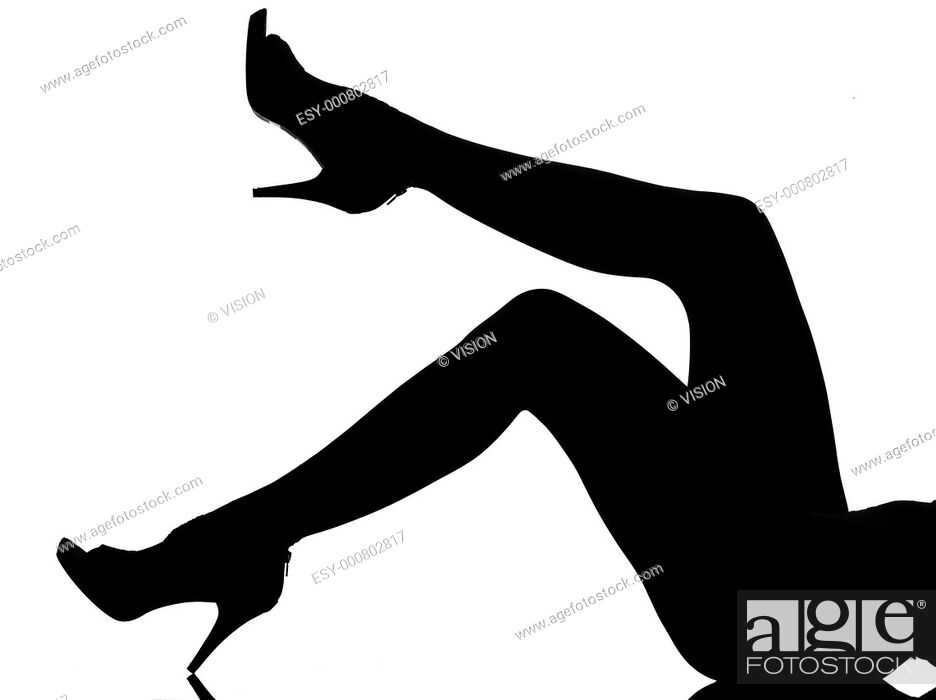 Stock Photo: silhouette in shadow of a young woman legs flapping in studio on white background isolated.