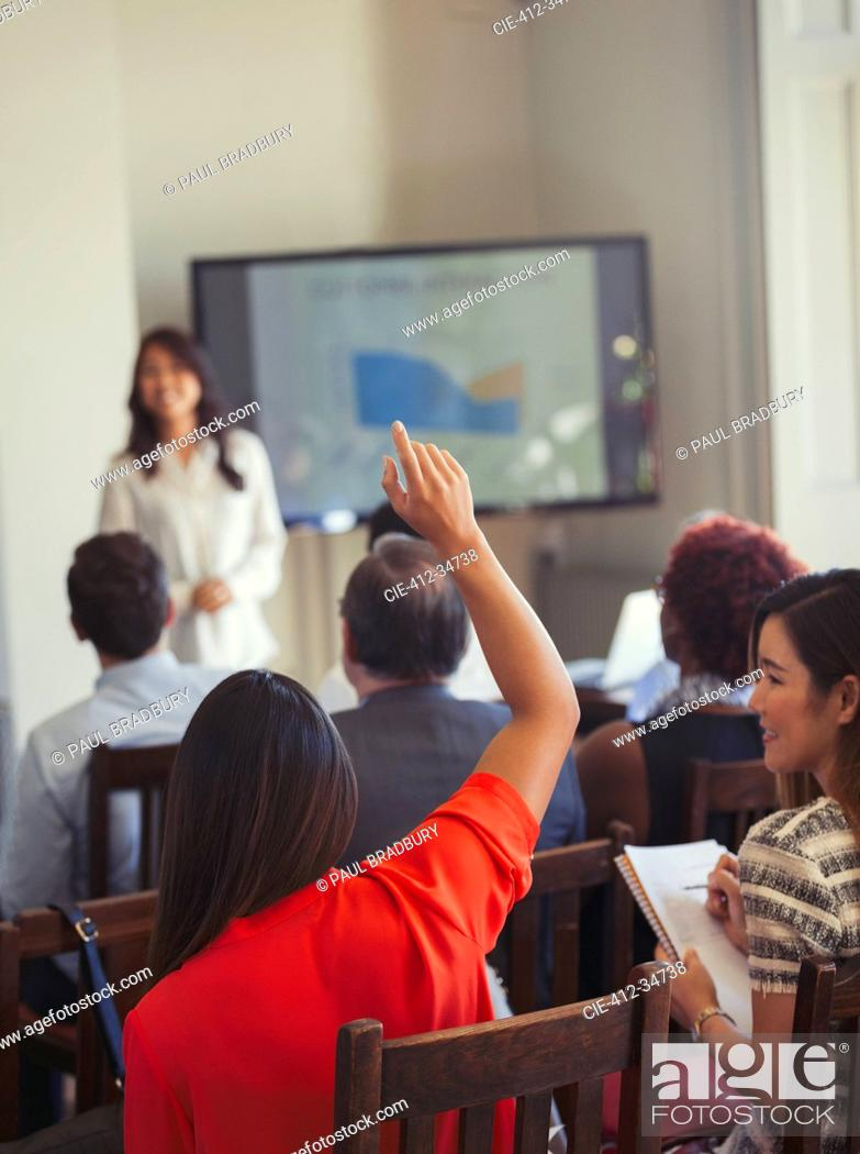 Stock Photo: Businesswoman in audience asking question at business conference.