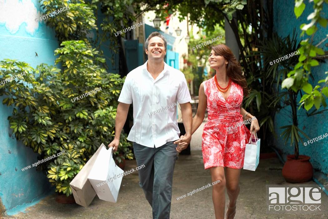 Stock Photo: Couple carrying shopping bags.