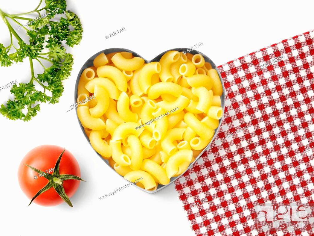 Stock Photo: Pasta in a heart-shaped biscuit cutter.