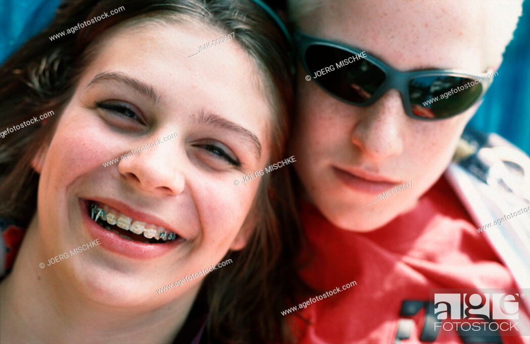 Stock Photo: Portrait of a boy and a girl, a young couple or friends.