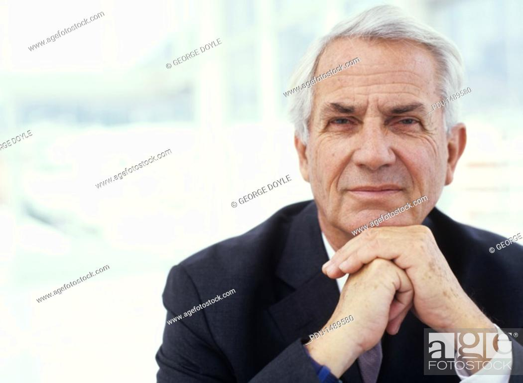 Stock Photo: Businessman with hands on chin, close up, portrait.