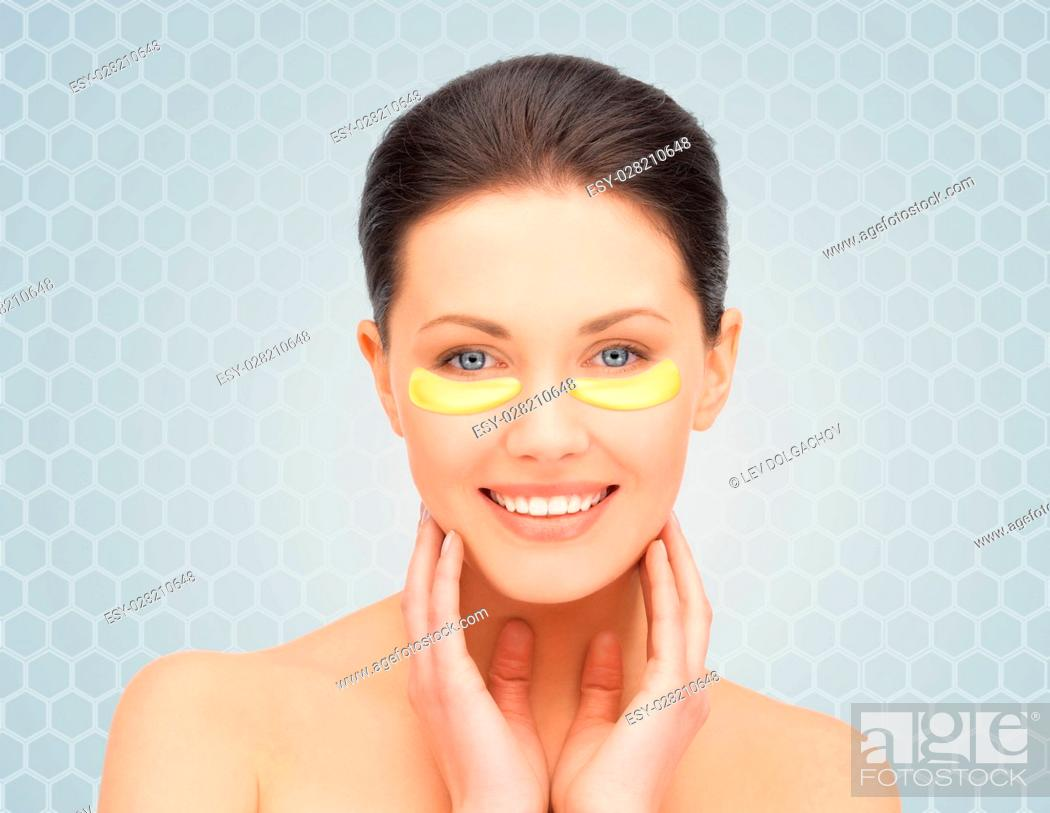 Stock Photo: beauty, cosmetology, hydration, people and rejuvenation concept - beautiful young woman face with hydrogel under-eye patches over gray background.