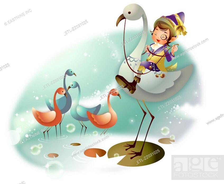 Stock Photo: Boy riding a flamingo.