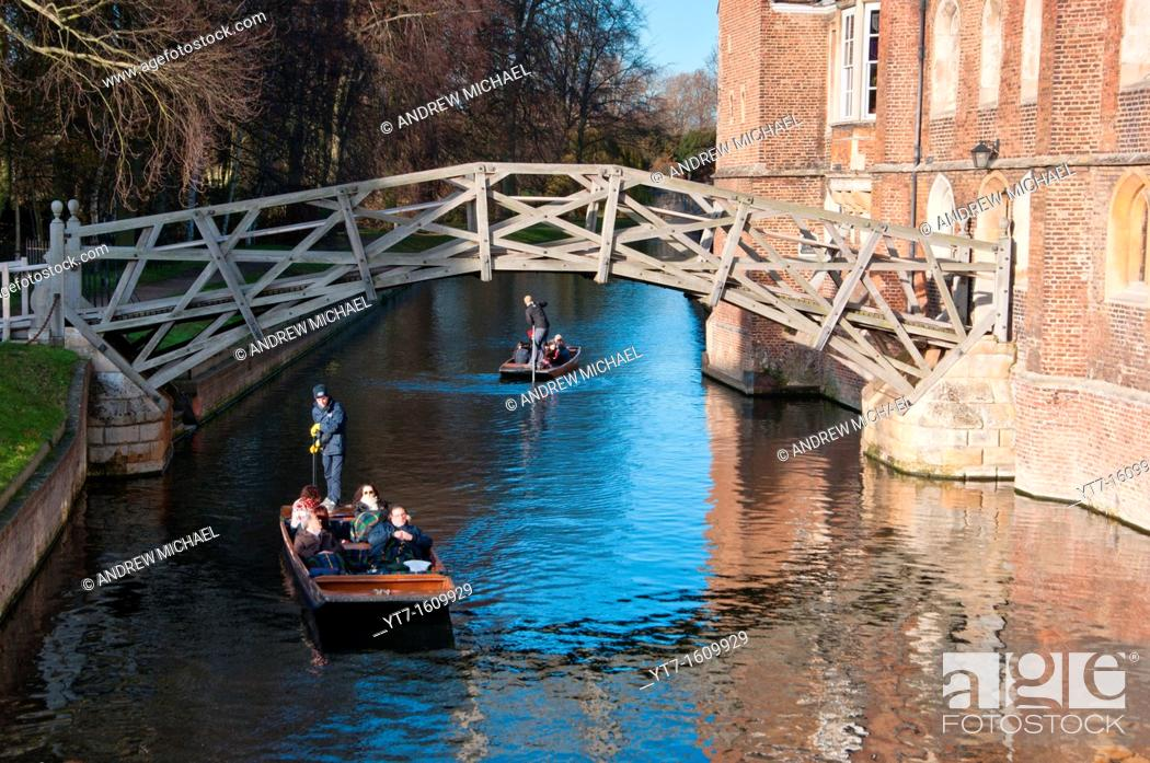 Stock Photo: Punters go under the Mathematical bridge at Queens College Cambridge  UK.