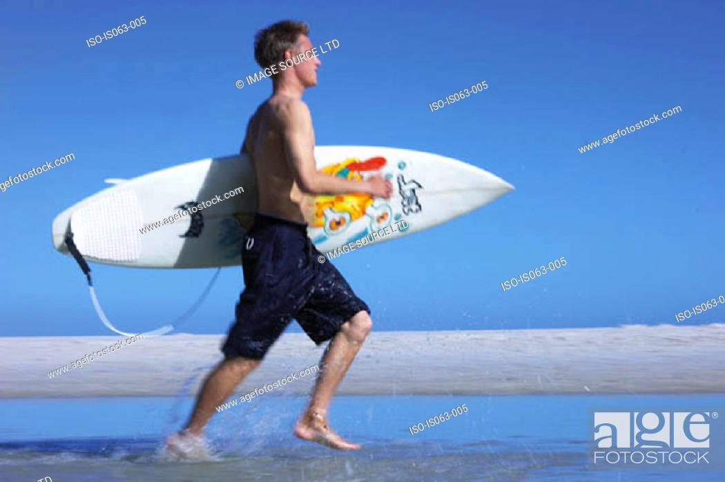 Stock Photo: Surfer running.