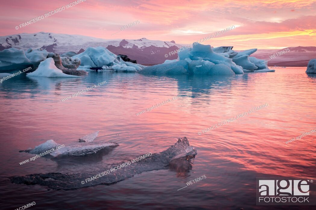 Stock Photo: Iceland, Jokulsarlon Glacier Lagoon, icebergs and ice chunk at sunset.