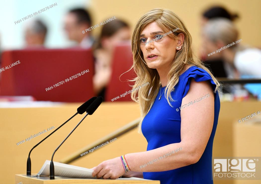 Stock Photo: 26 June 2019, Bavaria, Munich: Tessa Ganserer (Bündnis 90/Die Grünen) speaks at the plenary session of the Bavarian Parliament in the plenary hall.