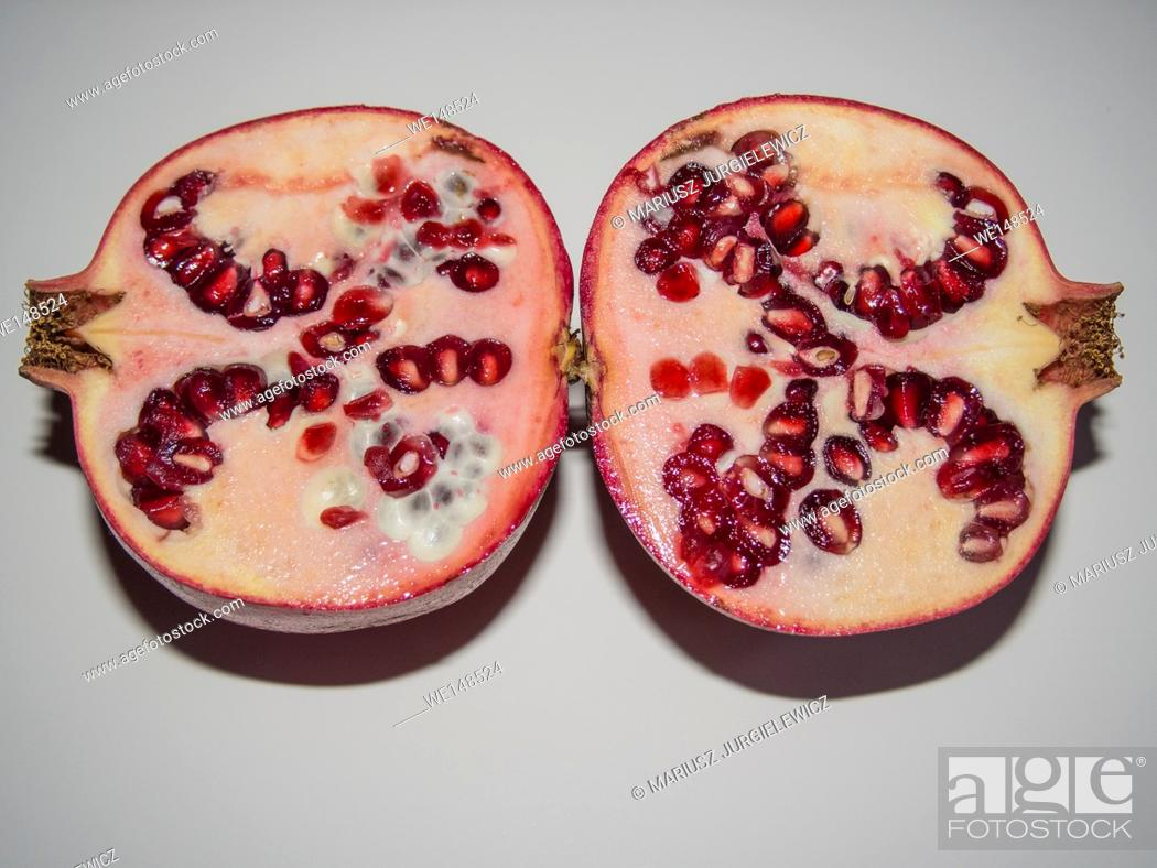 Stock Photo: Pomegranate (Punica granatum) is a fruit-bearing deciduous shrub or small tree growing between 5 and 8 m (16 and 26 ft) tall.