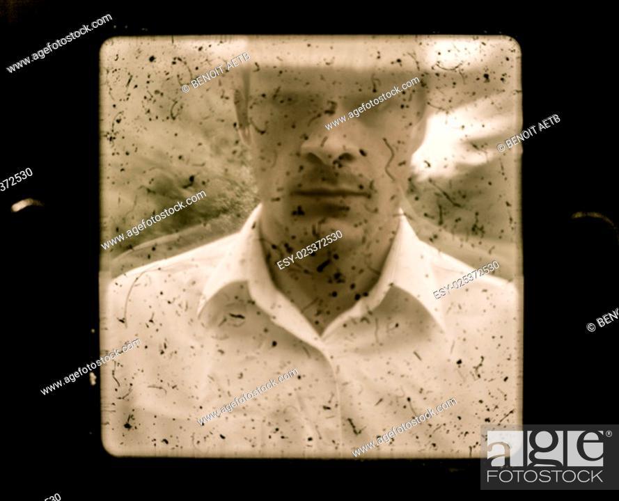 Stock Photo: Old Vintage Farmer Portrait using a dusty Camera.