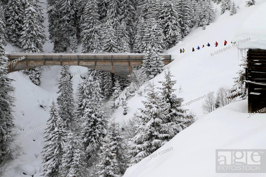 Stock Photo: Group of people about to cross bridge.