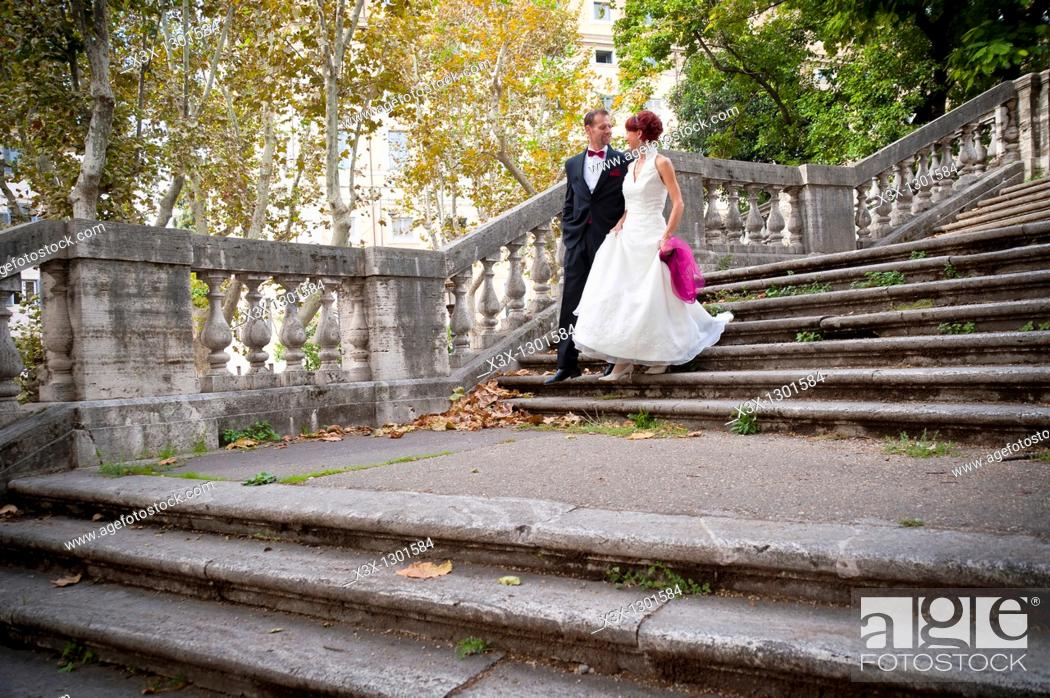 Stock Photo: Wedding couple descending stairs Rome Italy.