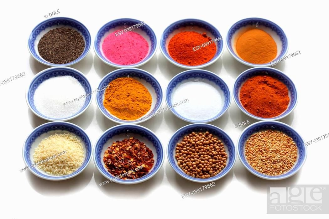 Stock Photo: Oriental spices in the bows over white background.