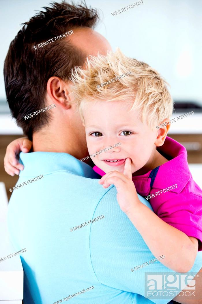 Stock Photo: Germany, Father carrying son.