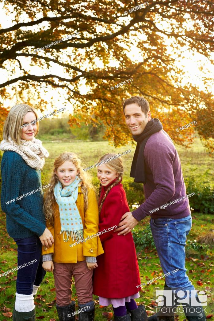 Stock Photo: Family smiling together outdoors.