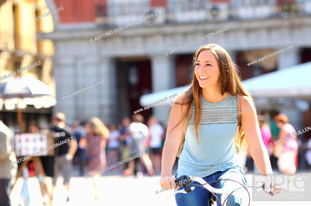 Stock Photo: Candid tourist cyclist sightseeing in a old town of a city.
