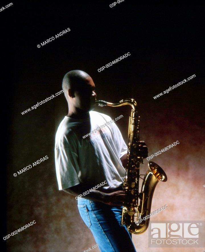 Stock Photo: a man playing saxophone.