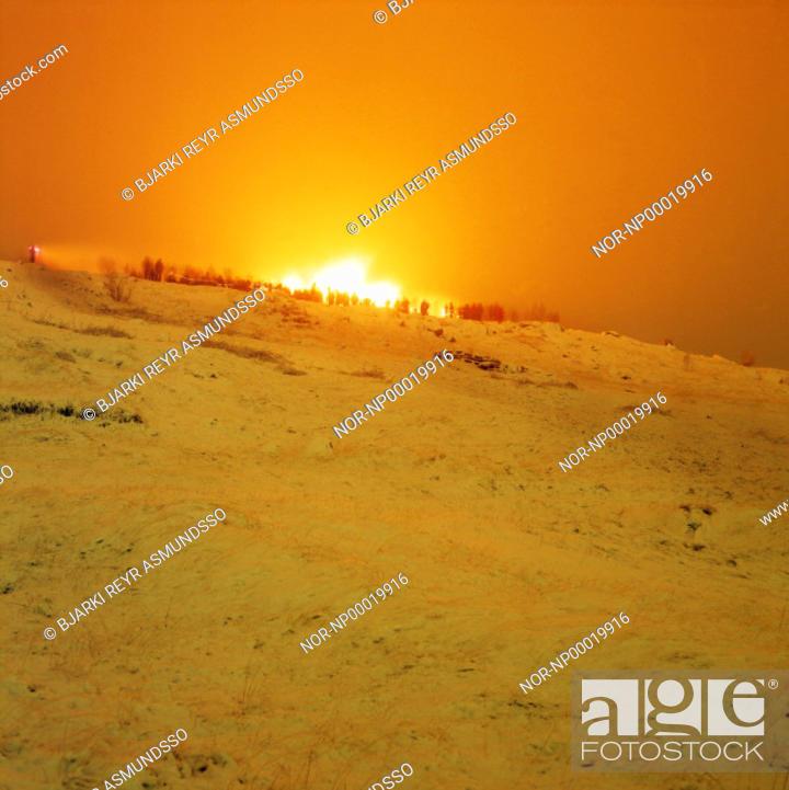 Stock Photo: People, bonfire, New Year's Eve.  Iceland, southwest, Hafnarfjordur, Asfjall Mt.
