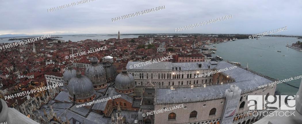 Stock Photo: 12 May 2019, Italy, Venedig: Wide angle: Eastern view from Campanile. From the Markusturm clouds lie over the city of Venice.