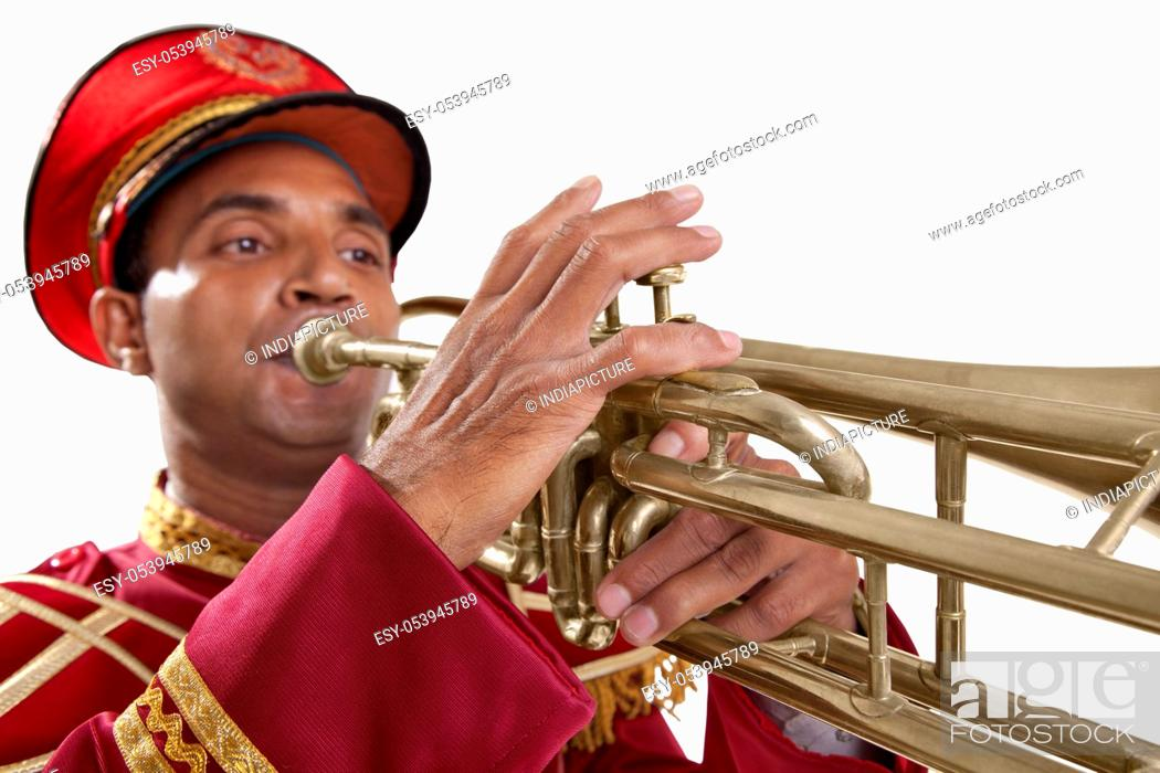 Stock Photo: Close-up of Bandmaster playing on a trumpet.
