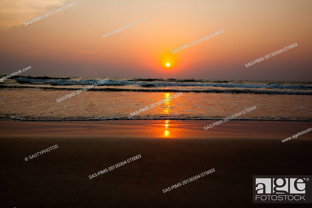 Stock Photo: Sunset over the sea, Goa, India.