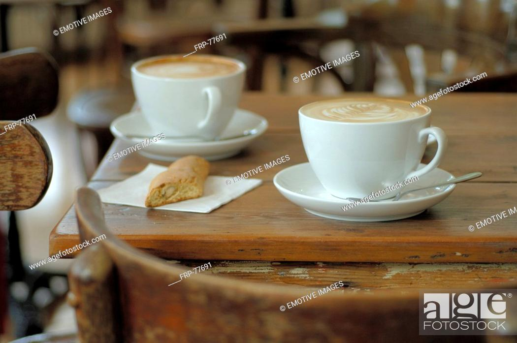Stock Photo: Cappuccini on a table.