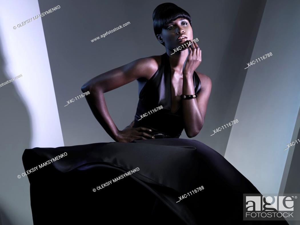 Stock Photo: Beautiful young woman wearing long black dress  High fashion photo.