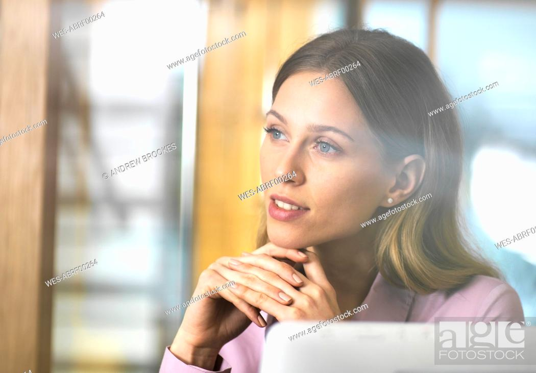 Stock Photo: Confident businesswoman in office thinking.