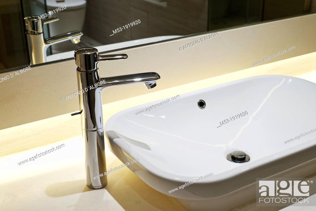 Stock Photo: Modern bathroom sink with mirror reflection.