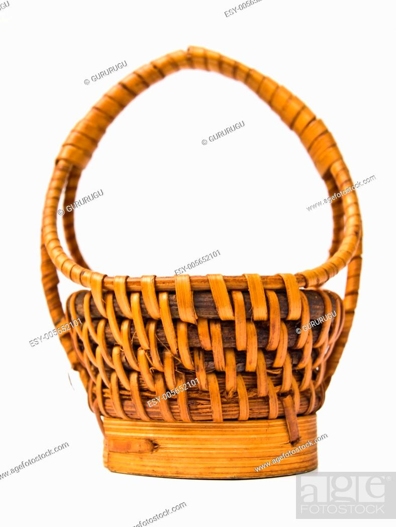 Stock Photo: A yellow wicker basket isolated on white background.