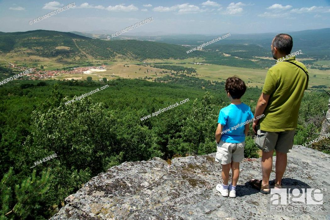 Stock Photo: Father and daughter looking at Canicosa de la Sierra, Burgos.