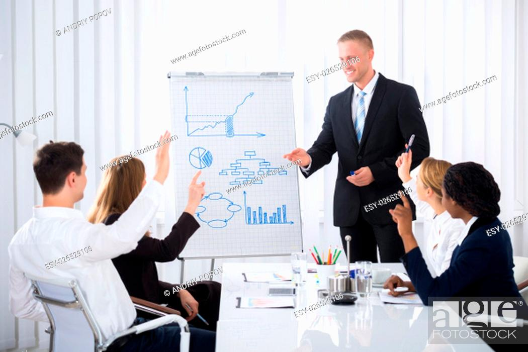Stock Photo: Group Of Businesspeople Raising Their Hands In Conference.