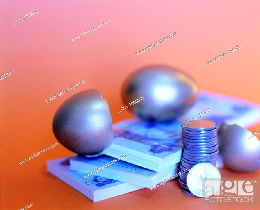 Stock Photo: United Arab Emirates money and broken eggshell.