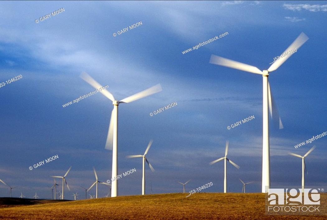 Stock Photo: Spinning wind turbines at dusk, Rio Vista, California USA.