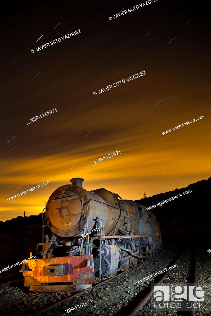 Stock Photo: Old steam locomotive on a starry night.