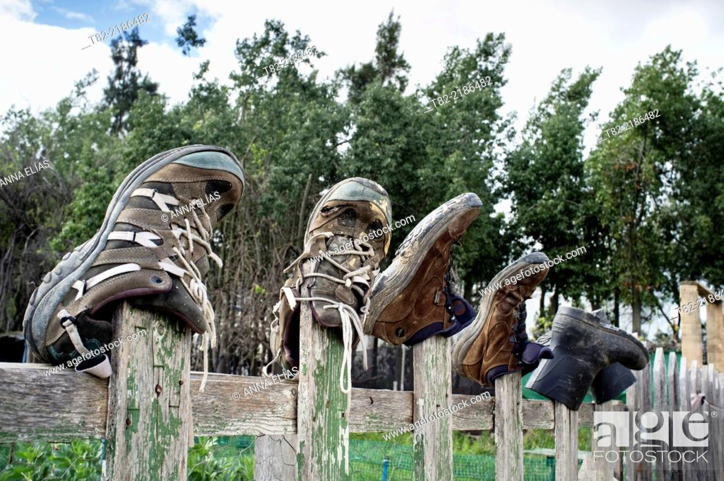 Stock Photo: different work shoes hanging from wooden railing, Seville, Andalucia, Spain, Europe.